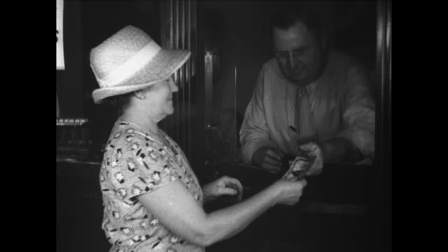 for the first time in history the us government reimburses the patrons of a defunct bank by cashing in their accounts for one hundred cents on the... - great depression stock videos & royalty-free footage