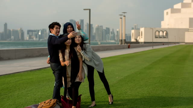 for very young korean tourists make selfies and embracing their life - doha stock videos & royalty-free footage