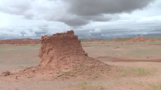 for years herder gelegrash had a sideline bringing tourists to see a dinosaur skull hidden near the flaming cliffs in mongolia's gobi desert - independent mongolia stock videos & royalty-free footage