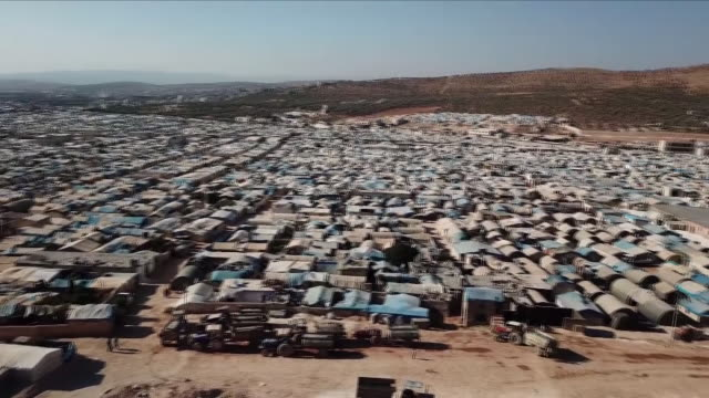 for years syria's defeated rebels have escaped to the northern territory of idlib and now this last rebel held city is under threat of attack from... - syrien stock-videos und b-roll-filmmaterial