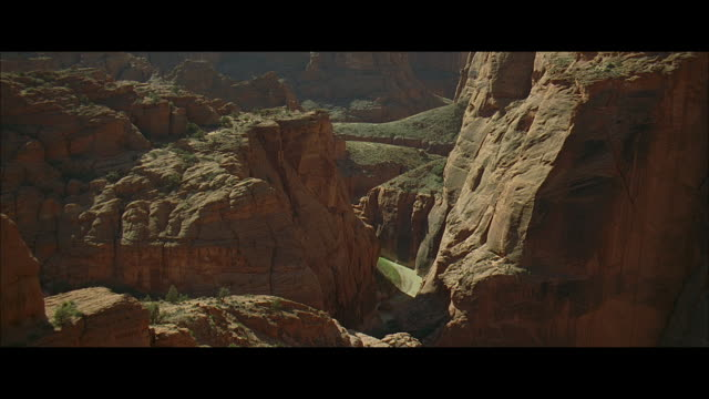 aerial forbidding arid mountain slopes, outcroppings, cliffs, ravines, and crags, with steep eroded walls - 50 seconds or greater stock videos & royalty-free footage