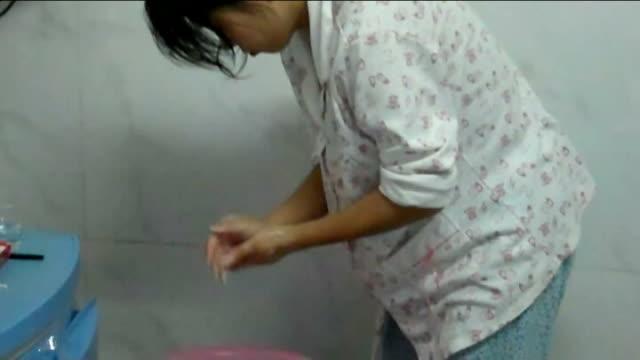 Feng Jianmei interview Feng Jianmei wahing her hands and face in hospital bathroom