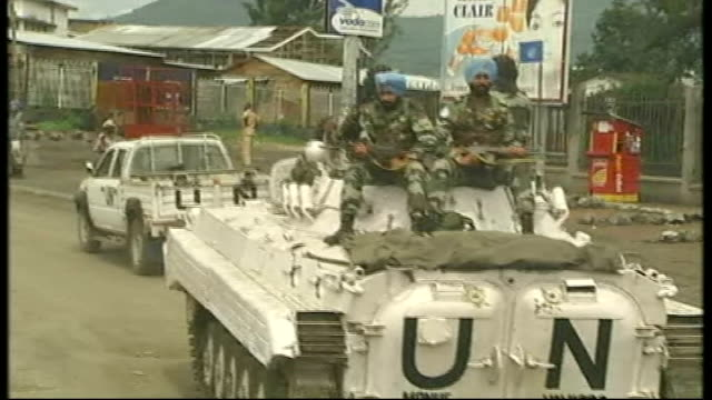 un forces chief reacts to massacre allegations democratic republic of the congo goma ext un peacekeeping troops sitting in back of vehicle un... - 平和維持点の映像素材/bロール