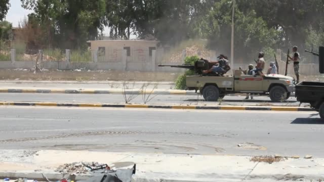 Forces loyal to Libya's Government of National Accord clash with DAESH militants at Second Street of Sirte Libya on August 14 2016