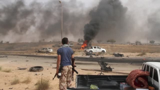 vídeos de stock, filmes e b-roll de forces loyal to libya's un backed government said monday they had seized full control of the city of sirte from the islamic state group dealing a... - líbia