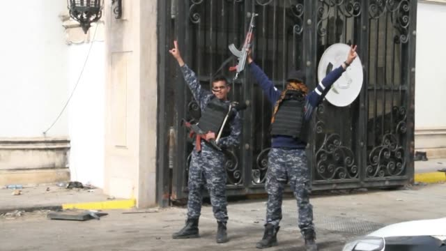 Forces loyal to Libya's UNbacked unity government seized the headquarters of a rival militia on Wednesday in a third day of intense fighting for...