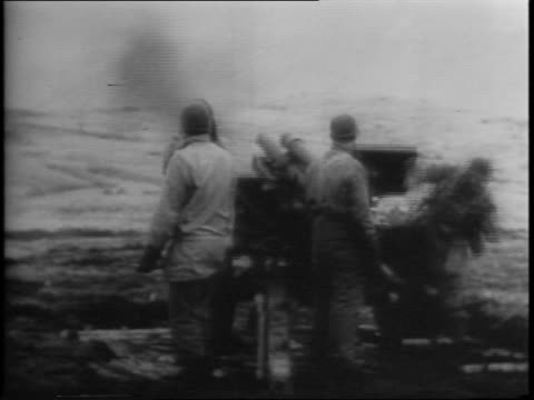 stockvideo's en b-roll-footage met forces make a surprise attack on the japanese held island of attu / map of attu, holtz bay, massacre bay / convoy of ships and bomber planes advance... - alaska verenigde staten