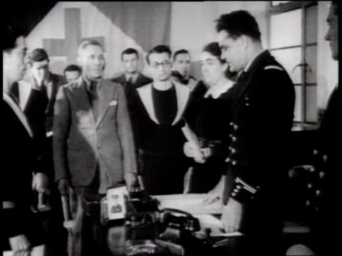 forces naval francaises libres building w/ sailor standing guard saluting officer swearing in recruits at desk recruits signing paperwork world war... - military recruit stock videos and b-roll footage