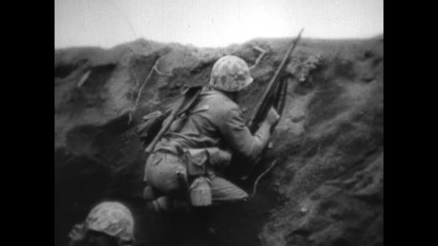 forces pinned down on beach of iwo jima m4 tanks soldiers maneuvering trying to get equipment on beach soldiers carrying wounded on stretcher - schlacht um iwojima stock-videos und b-roll-filmmaterial