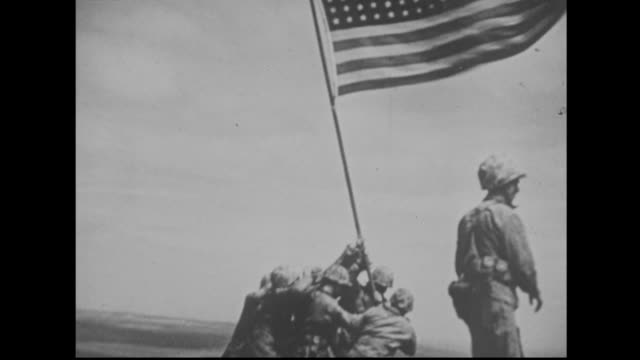 us forces raise the flag on iwo jima - battle of iwo jima stock videos and b-roll footage