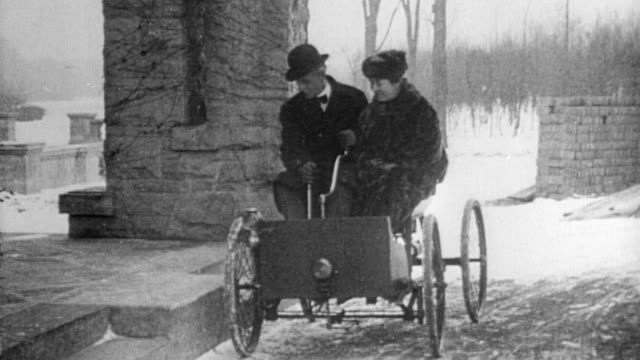 ford and his wife clara jane bryant pull up in his first 1896 car the quadricycle outside their fair lane home in dearborn michigan 1927 - dearborn michigan stock videos and b-roll footage