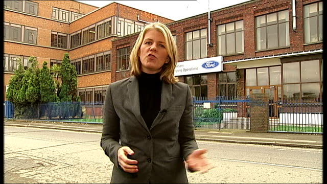 Ford announces factory closures in Dagenham and Southampton Barbed wire fence with 'Ford' sign in background PULL FOCUS sign Reporter to camera Vox...