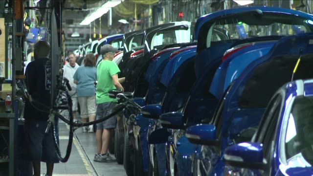 ford announces that it will invest $12 billion in three michigan plants most of which is part of a 2015 deal with its workers - ford motor company stock videos and b-roll footage