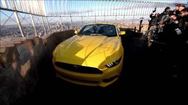 ford celebrated the 50th birthday of its beloved mustang by displaying a new model of the convertible on top of the empire state building in new york... - convertible top stock videos & royalty-free footage