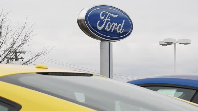 ford dealership signage with cars in foreground in matteson illinois on monday april 3 2017 - ford motor company stock videos & royalty-free footage