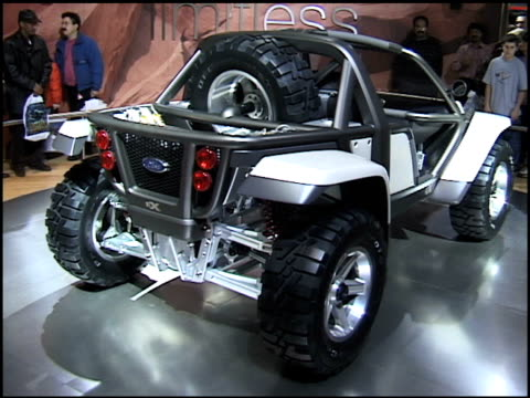 ws ford ex revolving on turntable / cu info sign / ws ha overhead of vehicle 2001 ford ex concept car montage at cobo hall on january 14 2001 in... - dune buggy stock videos and b-roll footage