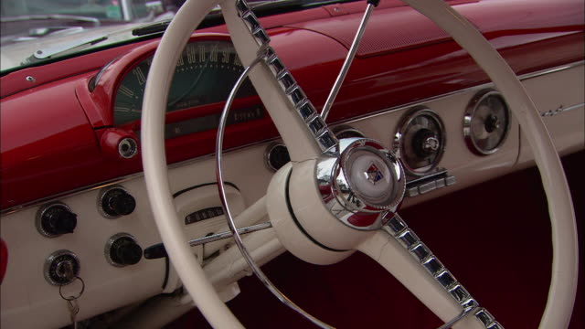 a 1965 ford fairlane features a red and white dashboard. - steering wheel stock videos & royalty-free footage