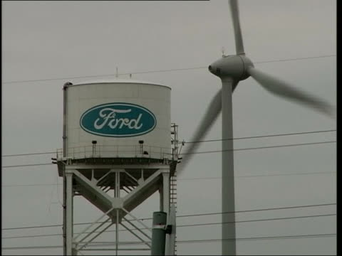 ford fiesta 30th anniversary la cms mcandrew posing for photocall dagenham general view ford factory tower with wind turbine in f/g derelict building... - dagenham stock videos & royalty-free footage