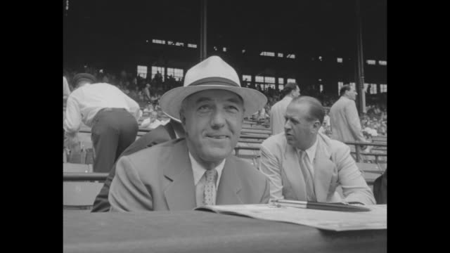 CU Ford Frick commissioner of baseball in grandstands at AllStar Game at Cleveland Stadium / William Harridge president secretary and treasurer of...