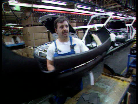 ford job losses int car workers at work on production line lib c5f - loss stock videos & royalty-free footage