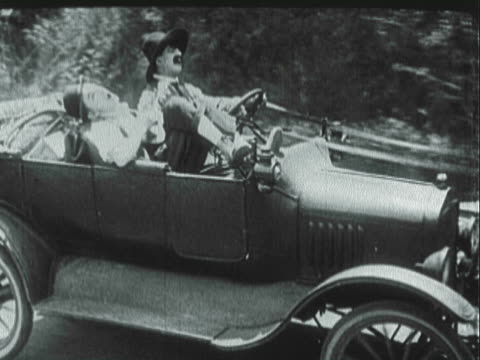 montage ford model t convertible with driver and passenger being pulled by a mule / united states - 1921年点の映像素材/bロール
