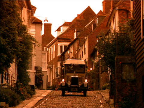 ford model t truck drives along cobbled street - ford truck stock videos and b-roll footage