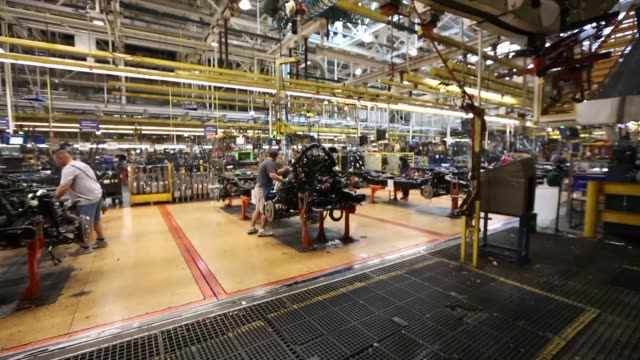 ford motor company's 2014 f150 on the line at their dearborn assembly in dearborn michigan on monday workers stand on the automated factory floor... - ford motor company stock videos & royalty-free footage