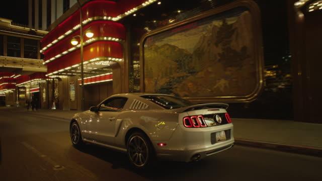 ford mustang drives down the strip, las vegas - 高級車点の映像素材/bロール