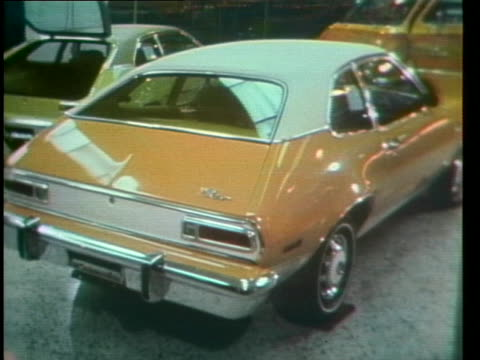 ford pinto cars sit on display in a showroom in detroit. - ford motor company stock videos & royalty-free footage