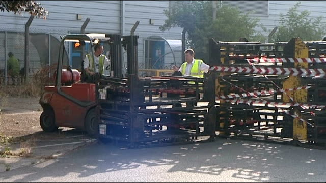 ford plant - last shift at southampton plant gvs; england: hampshire: southampton: ford: ext crates being moved at ford plant / 'no trespassing' sign... - no parking sign stock videos & royalty-free footage
