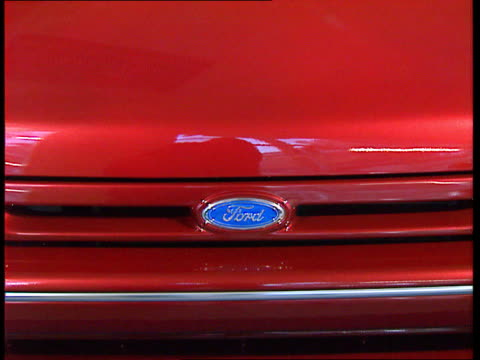 ford price rise england lms ford car showroom pan lr cs ford logo on bonnet tilt lms ford car in showroom ms ditto - ford motor company stock videos and b-roll footage