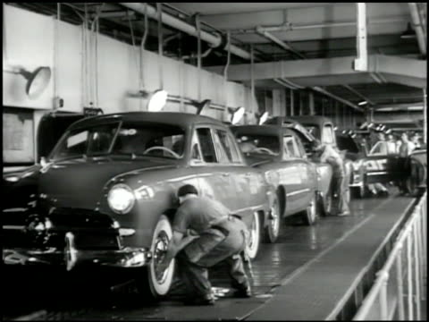 ford sedan assembly line factory worker inserting hub cabs ms ford sedan in assembly line front hood open mechanic talking adjusting under hood - 1949 stock videos and b-roll footage