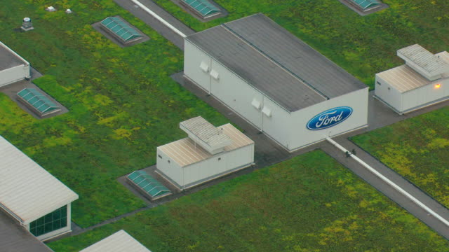 CU AERIAL Ford sign on building and living roof on top of factory at Truck Plant / Dearborn, Michigan, United States