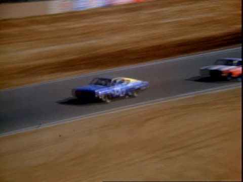 Ford stock car and Dodge racing competing in Riverside 500 aka Motor Trend 500 at Riverside International Raceway the Ford veers off track on tight...