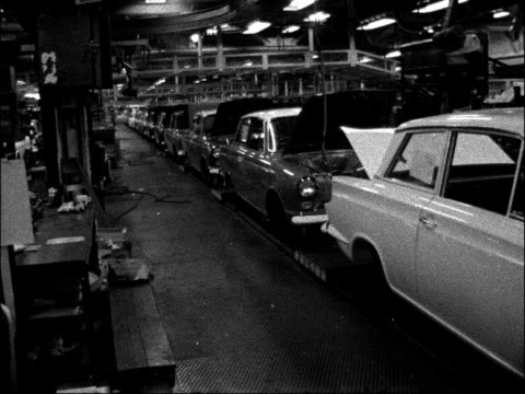 ford strike goes on over sacking of shop steward england dagenham int various of ford cars on deserted factory assembly line - dagenham stock videos & royalty-free footage