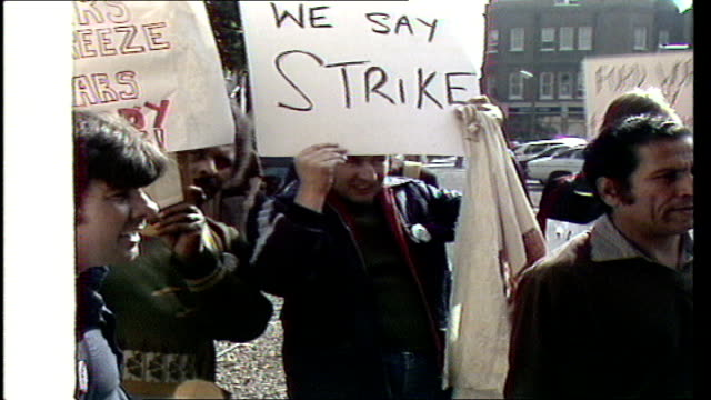 """ford strike - unions reject 5% pay offer; england: london cms smith, sof: """"the company's total.... ...situation"""": demonstrators and placards: ron... - trade union stock videos & royalty-free footage"""