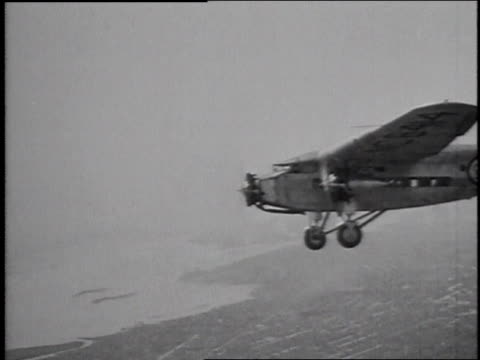 1929 montage ford tri-motor airplane flying in the sky / united states - 1920 1929 stock videos and b-roll footage