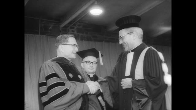 fordham college on the occasion of its 125th anniversary / procession of theologians walk their way inside to convocation ceremony / rev pedro arrupe... - anno 1966 video stock e b–roll