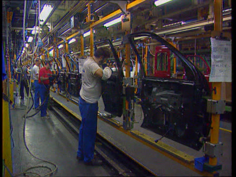 ford/vauxhall jobs announced; lib wales: mid glamorgan: bridgend int ford workers on production line in bridgend plant - mid wales stock videos & royalty-free footage