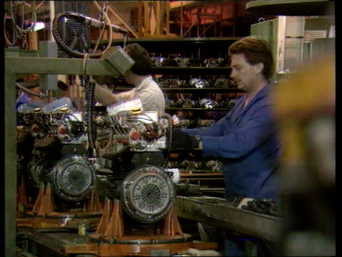 Ford/Vauxhall jobs announcement TX 291196 / ITN U'Lay Ford workers assembling car engines on production line