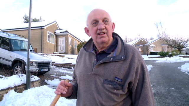 forecasters warn of further snowy conditions; low angle view of a snow shovel being used tio clear now by pensioner john wagstaff wagstaff clearing... - road closed sign stock videos & royalty-free footage