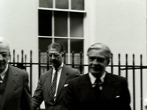 Foregin Secretary Anthony Eden and US Foreign Secretary John Dulles walk along Downing Street