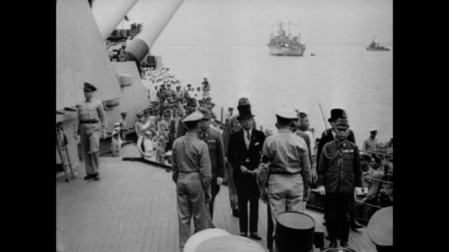 / Foreign Affairs minister for Japan Mamoru Shigemitsu limps on board USS Missouri / followed on board by Chief of the Imperial Staff General...
