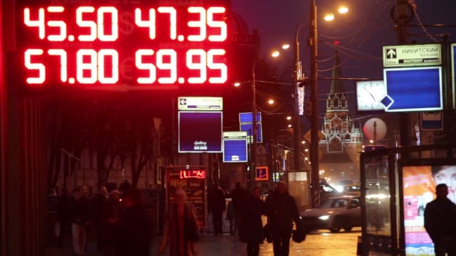foreign currency exchange rates sit illuminated on an electronic sign outside a currency exchange bureau in moscow russia on sunday nov 9 gvs of... - 整理ダンス点の映像素材/bロール