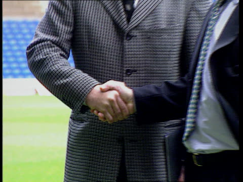 foreign managers lib gross shaking hands with alan sugar - alan sugar stock videos and b-roll footage