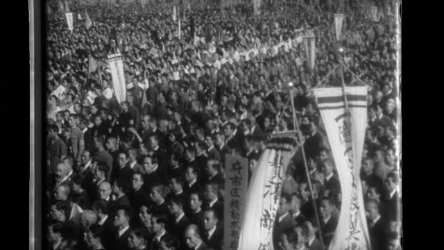 Foreign Minister Yosuke Matsuoka reads a proclamation by Prime Minister Konoe to 20000 citizens joined by Yoriyasu Arima Secretary General of...