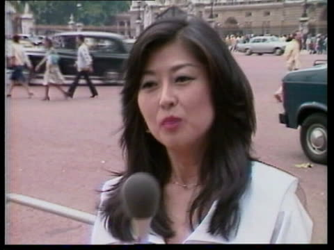foreign press; royal wedding: foreign press; england: london: buckingham palace horse guards r-l out of palace pull back japanese reporter to tv and... - television show stock videos & royalty-free footage