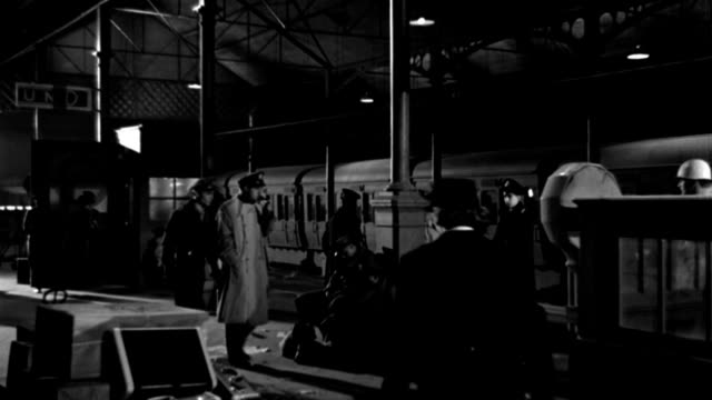 dx - foreign railroad train station, london - set: down euston station platform, during world war ii - atmosphere busy - civilians, people in u.s. and british uniforms - b&w. - military uniform stock videos & royalty-free footage