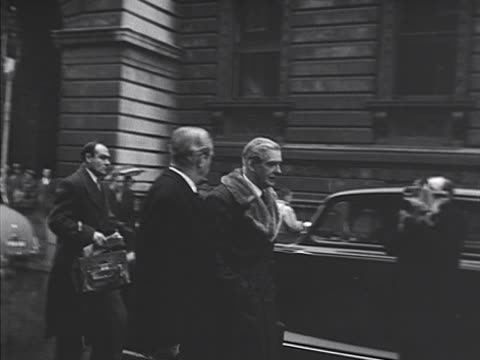 Foreign Secretary Anthony Eden and Defence Minister Harold MacMillan walk along Downing Street