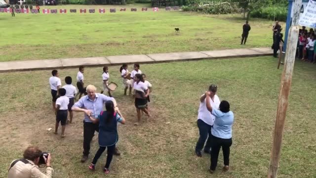 foreign secretary boris johnson dances with infant class teacher adriana pinedo at the village school in santa marta on a bank of the amazon in peru... - boris johnson stock videos and b-roll footage